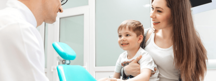 a dentist with a patient and child
