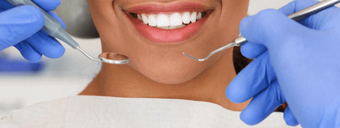 women with perfect teeth sitting in a dentists chair