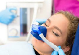 a women with a sedation dentistry mask before dental care treatment