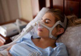 women using a sleep apnea machine to sleep