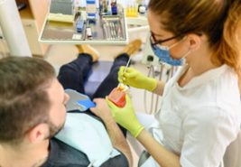 dental professional showing a patient the various layers of teeth
